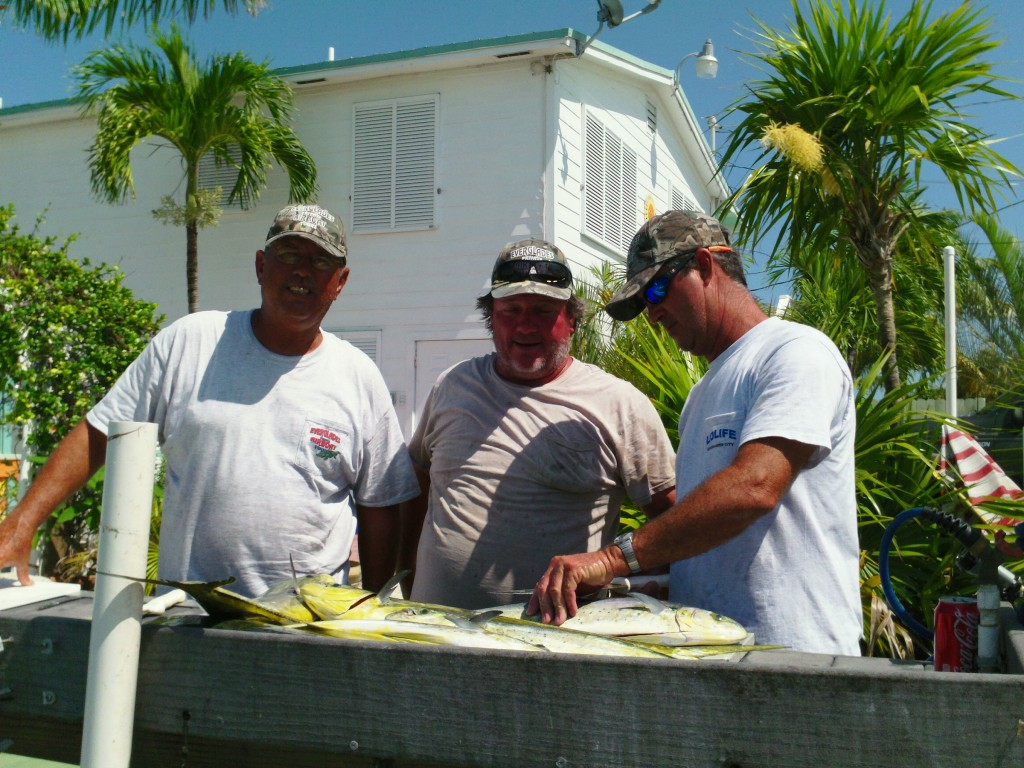Cleaning fish after a long day on the salty blue Atlantic